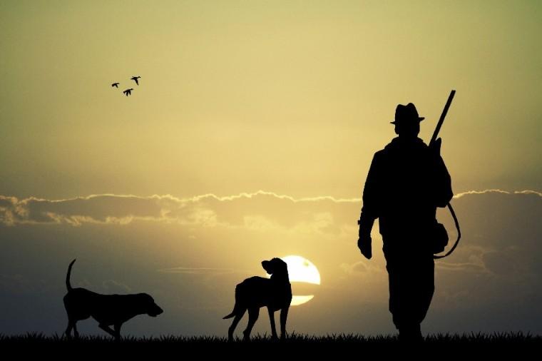 Jaeger mit Hund